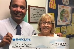 Pam Saywer presents the CEDHAR cheque to Professor Sathya.