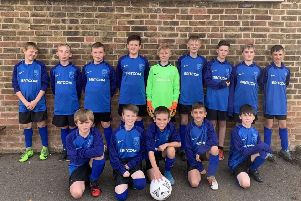 The Market Weighton Year Seven football team in the kit sponsored by Britcom.