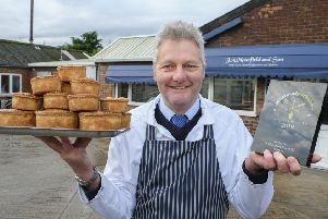 David Mounfield of J A Mounfield & Son Ltd of Bubwith is pictured with his Taste Award and some delicious Yorkshire Pork Pies.