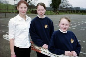 Why did these three Woldgate students feature in the paper in 2000?