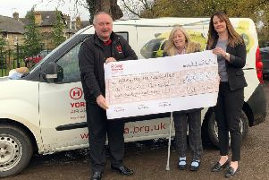 Yorkshire Air Ambulance fundraiser Kevin Hutchinson receives a cheque from Barratt Developments Yorkshire East.