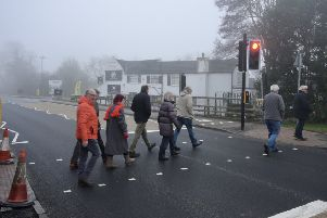 People use the new pedestrian crossing on the A1079 at Shiptonthorpe.