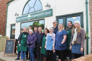 Volunteers at the opening of Bishop Wilton's new community shop.