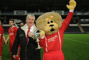 Brid Town chairman Peter Smurthwaite and club mascot Leon the Lion