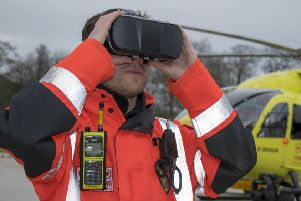 Yorkshire Air Ambulance paramedic Lee Greenwood tries out the new VR goggles and a patient's view of landing at Leeds General Infirmary helipad.