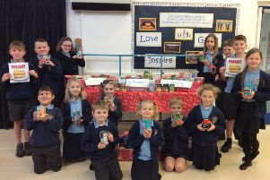 St Mary and St Joseph RC Primary School children with some of the food items donated to the Project Hotdog charity.