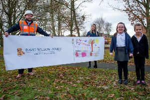 Beatrice Wharfedale and Isla Saunders have seen their designs on the road safety banner at Saxon Gate.