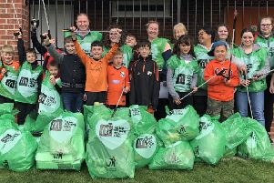Volunteers from the McDonald's restaurant with players from Holme Rovers Football Club.