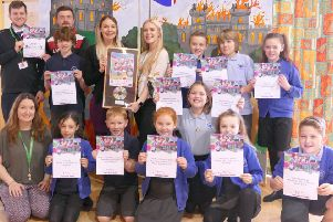 Pocklington Community Junior School pupils with the Rock Challenge prize and certificates.
