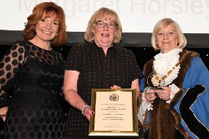 Margaret Horsley, centre, is presented with her Chairman's Award.