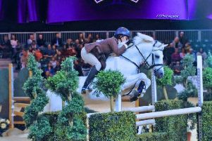 One of Glenwood's horses, Newtown Molls Pride, is pictured show jumping at Horse of the Year Show.