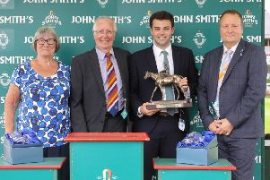Betty and Allen Clovis present the John Smith's City Wall Stakes trophy to the winners.