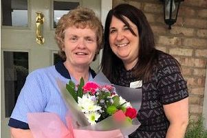 Registered nurse Margaret Mill was presented with flowers, gift vouchers and a gold pin.