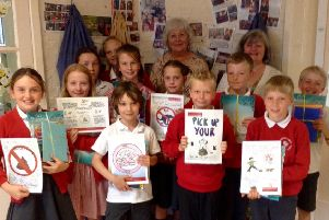 Pupils at Sutton upon Derwent created posters which will be placed around the village to stop dog fouling.