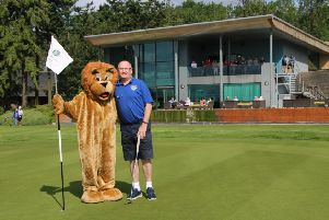 Pocko, the Lions Mascot, helps promote the golf day at the KP Club.