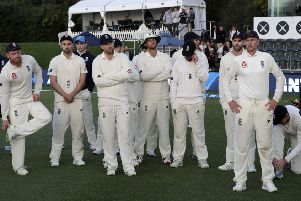 England captain Joe Root, right, stands with his team following the final day of the second Test against New Zealand at Hagley Oval. Picture: AP/Mark Baker