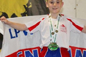 George Emsley shows off the silver medals he won at the World Karate and Kickboxing Championships in Ireland.