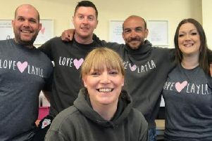 Stacey Dennis, front, with the Love Layla team