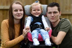 Imogen Holmes pictured in March 2018  with her parents Briony Winstanley and  Stephen Holmes.