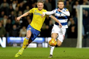 Luke Ayling chases after the ball with Luke Freeman in Leeds United's defeat at QPR.  Picture: Bruce Rollinson