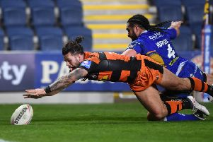 Alex Foster touches down ahead of Konrad Hurrell late on at Headingley.