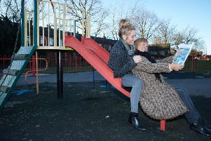 Zoe Gaitley and Jo Pollitt with plans for the new play area before it was attacked by vandals.