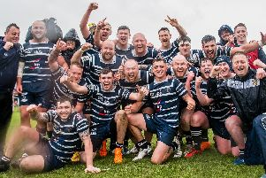 Featherstone Lions players celebrate their victory over the leaders. Picture: Jonathan Buck