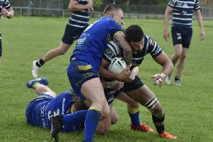 Featherstone Lions' Gareth Gale tries to find a way to the line against York Acorn. Picture: MATTHEW MERRICK
