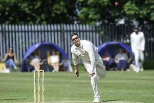 Six wickets: Townville's Jack Hughes.