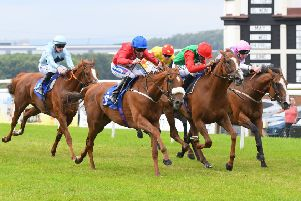 Exhort, ridden by Paul Hanagan, gets up in a thrilling finish to win the Weatherbys TBA Pipalong Stakes at Pontefract. Picture: Alan Wright