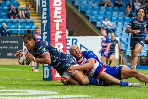 Ashton Golding plunges over for Featherstone Rovers. PIC: James Heaton.