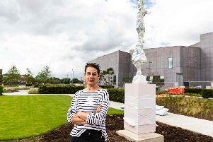 Rebecca Warren installs her sculpture 'The Three' in The Hepworth Wakefield Garden. Photo: Nick Singleton