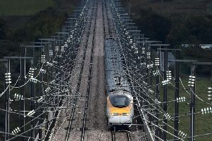 The arrival of high-speed rail in Leeds could be delayed because of a dispute over whether a 6bn underground station should be built in Manchester.