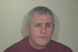 Garage owner Christopher Askham was jailed for three years for road rage attack on motorcyclist.
