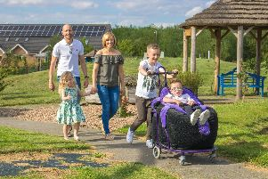 Jacob White and his family taking a walk in the hospice gardens