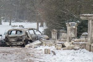 A car was used to smash the bridge's ornamental pillars and abandoned at the site.
