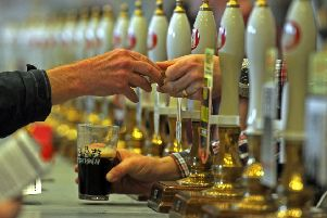 HAND-PULL: A punter pays for his cask ale with a token at the bar. Picture reference: Drinkers Top 10 Beer fest.