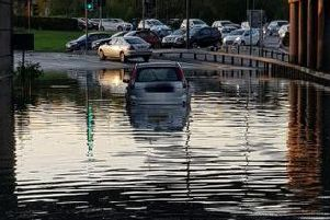Car stuck in a flooded Chesterfield road.