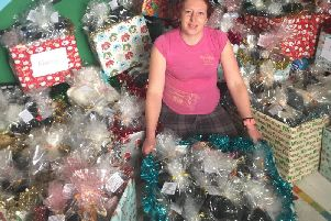 Sarah Marriott with the boxes filled with gifts for the homeless.