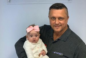 Adrian Buttress, MD of Permaroof, with his grandaughter River