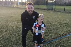 One of Heanor Town Juniors' star players, pictured with his manager.