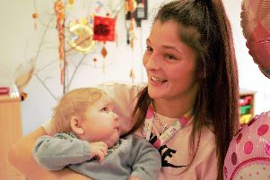 A smile from proud mum Laura Bagworth for her ill baby daughter Arliya-Leigh.