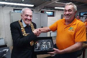 Coun John Walker, mayor of Amber Valley, presenting a specially engraved crystal decanter to Pete