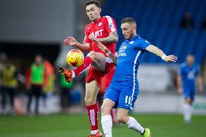 Peterborough vs Chesterfield - Jay O'Shea beats Peterborough's Marcus Maddison to the ball - Pic By James Williamson
