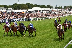 Five in a line as Anthony Van Dyck (nearside) pips four rivals to win Saturday's Investec Derby at Epsom. (PHOTO BY: Glyn Kirk/Getty Images).