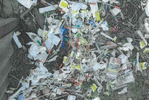 Chesterfield magistrates' court was presented with an image by NE Derbyshire District Council showing fly-tipping in the Tupton area with dumped hypodermic needles and drug paraphernalia associated with heroin use.