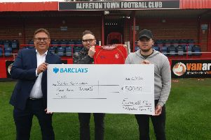 Pictured are Eurocell head of marketing, Chris Coxon, with Ross Fairhurst, the firm's digital marketing manager and Alfreton Town FC midfielder Jordan Sinnott with a cheque for 500 for the South Normanton Foodbank - Trussell Trust.