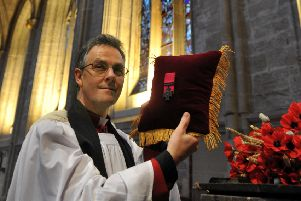 The Dean of Ripon Cathedral the Very Rev John Dobson, with the Victoria Cross awarded to  Lt Col Neville Bowes Elliott-Cooper.
