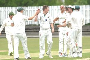 Ash Griffin, centre, took five wickets to help Harrogate CC to an important success over Castleford. Picture: Adrian Murray