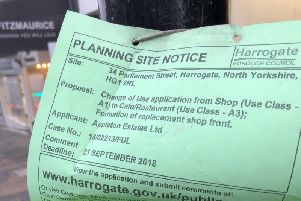 One of the planning application signs on Parliament Street in Harrogate.